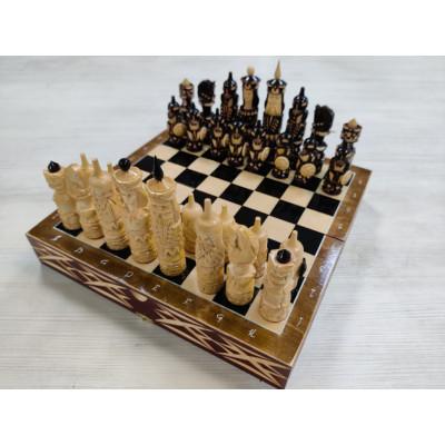 Шахматы резные Ледовая битва на резной доске